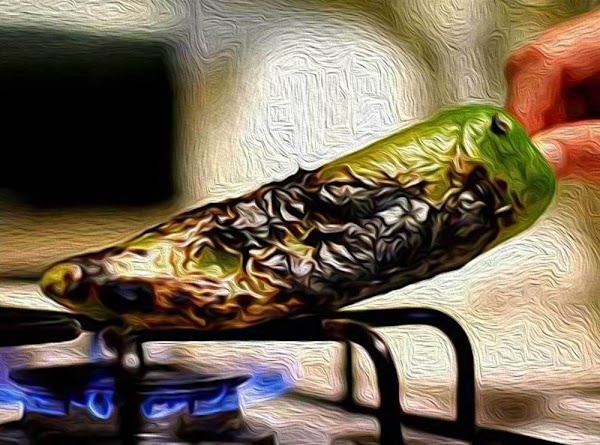 Preparing the Chilies: Roast the chilies on a grill, over the open flame of...