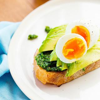 Breakfast Of Pesto, Avocado & Egg On Sourdough Toast.
