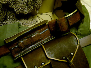 Photo: Here is the Magnetoscabbard (TM) I invented and she made real! Those squares are some of those curiously strong magnets that actually holds up the 9 lbs of stainless steel the sword is made of.