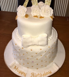 70th ivory and gold birthday cake