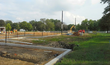 Photo: Joe Daniels Construction placing backstop pole 08-05-2014