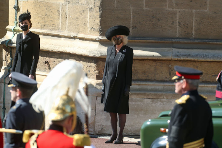 Prince William's wife, Catherine, Duchess of Cambridge (left), and her mother-in-law, Camilla, Duchess of Cornwall, watch the funeral procession of Prince Philip, Duke of Edinburgh.