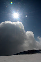 Photo: Sun and clouds rising over Çakmak Peak