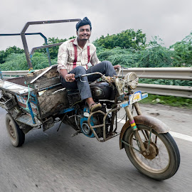 Speed by Anatoliy Kosterev - People Professional People ( driver, road, india, speed, bike )
