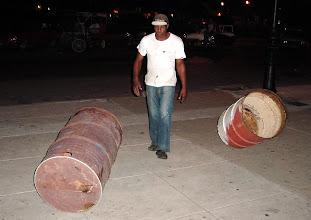 Photo: man spinning two barrels. cuba. Tracey Eaton photo.