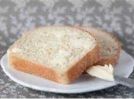 Preheat oven to 350* Lightly butter one side of the bread slices, cut bread into...