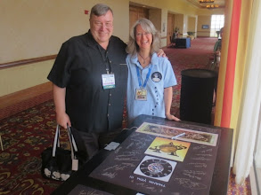 Photo: BYU Professor of Astronomy & Physics Mike Joner, and our dear Aleox with her posters for everyone at SpaceFest V to sign!