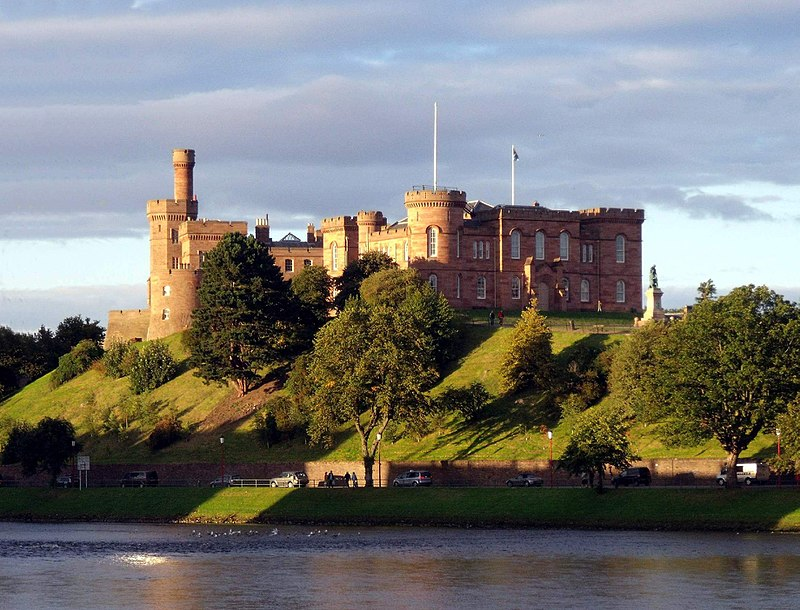 inverness castle. hilltop castle near a river is made from red brick, illuminated by the sun during sunset. beautiful sunset in united kingdom.