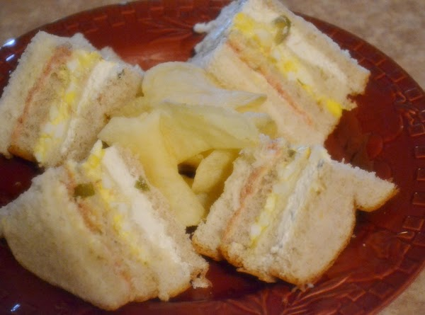 To serve:   cut each sandwich into 4 triangles and arrange on serving...