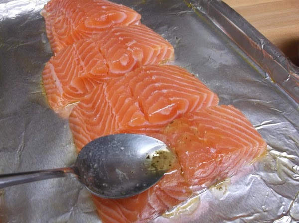 Spoon or pour melted butter mixture over salmon, turning each piece to evenly coat...