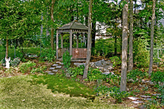 Photo: Grass wouldn't grow in this wooded lot so we installed a gazebo,  a path and shade tolerant plantings.