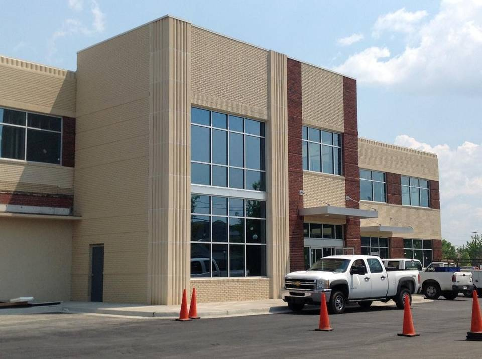 A 26,000-square-foot loft office building, shown Thursday at 408 12th St., at the intersection of Veterans Parkway in downtown Columbus, is moving toward completion. The structure, which has been rehabilitated at a cost of $3.1 million, is the former home of Strickland Motors years ago. --