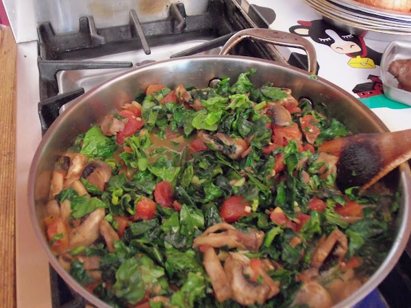 Pre-heat oven to 350 degrees. Heat butter in skillet. Add mushrooms, spinach, scalions, green...