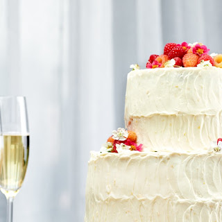 Vanilla–Buttermilk Wedding Cake With Raspberries and Orange–Cream Cheese Frosting