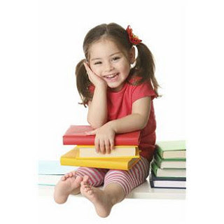 Little girl sitting on stack of books laughing