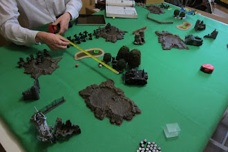 Photo: Turn 1 - end of Dark Eldar turn - Moving up, Chaos Rhinos going through the middle and Dark Eldar Raiders moving on the flanks. No hits from the Dark Lances on the Raiders, no hits from the Rhino on the Snipers in the trees.