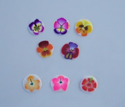 """Photo: The top 3 pansy and bottom 3 hibiscus flowers are $4.00 each. 1"""" long and 1/2"""" D. The middle 2 pansies are $3.50 each."""