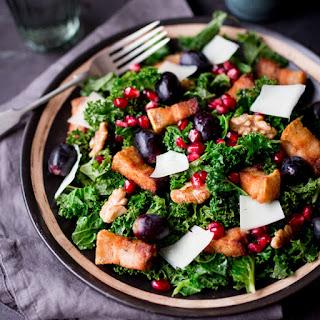 Warm Kale & Pork Belly Salad with Pomegranate Dressing.