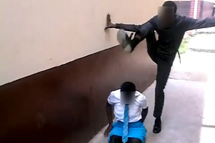 A young man is seen hitting and kicking a schoolgirl in this unverified video that is circulating on social media.