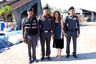 Photo: barefoot Tracey with the military police at the pier