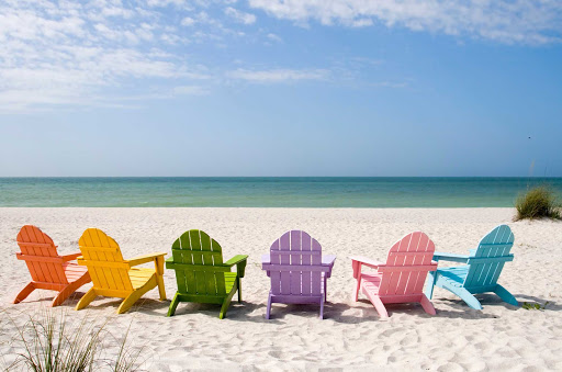 Cuba-Colorful-Chairs-on-Beach.jpg - The beaches of Cuba await. Board Adonia, a Fathom cruise, to visit Havana, Cienfuegos and Santiago de Cuba.