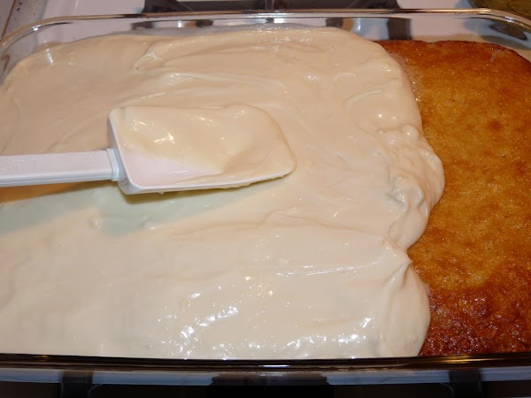 Spread the frosting on the warm cake right in the pan. Let cool, then...
