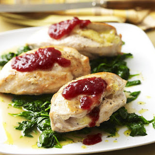 Brie Stuffed Chicken with Cranberry Sauce and Spinach.