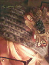 Photo: This knitted headband with feather flower has been the most complimented item in my winter experience in 2013-14. I like it a lot and am happy I wandered in Fred Meyer looking for a wrap=around neck cowl and found this and a scarf. I love it. It is cozy.