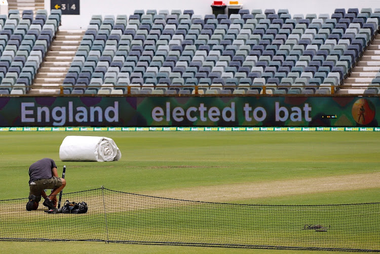 A worker sets up the stumps at the Waca ground in Perth, Australia, on December 13, 2017. Picture: REUTERS