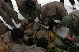 Photo: TAYLOR PARK, Colo. -- Soldiers from A Co., 3rd Battalion, 10th Special Forces Group (Airborne), construct a medical litter out of wood and skis during cold weather exposure training here, Jan. 23. (Photo by Staff Sgt. Michael R. Noggle)