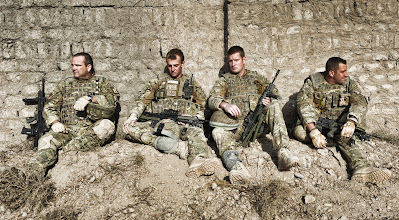 """Photo: The team take a break during the operation on the Bandi Barq RoadL-R: WO2 Iain Martin (38), IED Disposal operator;  LCpl Damon Dixon (22), Electronic Counter-Measures Operator; LCpl Gareth Todd (25), IED Disposal Infantry Escort; Cpl Steven Hunter (29), IED Disposal Number 2.---BOMB DISPOSAL SOLDIERS FIND AND DEFUSE RECORD NUMBER OF IEDs A team of British Army bomb disposal specialists have found and rendered safe a record TWELVE improvised explosive devices in one operation.The result – the greatest number of IEDs to be found and removed on any search so far on the current Operation HERRICK 13 tour – was the outcome of a high-risk clearance operation launched in the Gereshk area of Helmand province.The devices, which ranged in size from 5kg to 15kg and were targeted at both vehicles and troops on foot, were found by a Royal Engineers Search Team. All 12 were defused by Royal Logistic Corps Ammunition Technical Officer, Warrant Officer Class 2 Iain Martin.The IEDs were all pressure-plate initiated and located within 300 metres of each other on a route known as Bandi Barq Road. Also found, in addition to the complete devices, were two separate pressure plates and another main charge containing 5kg of explosive material.Warrant Officer Class 2 Iain Martin, Royal Logistic Corps, who is 39-years-old and comes from Craigiehall, Edinburgh, said:""""This was a huge variety of IEDs, all within a short distance, and represented a real challenge for us. Our reward came when we had finished and an Afghan family came up on to the road with their herd of goats, looking around like they hadn't trodden on the land in years. The local people have confidence in us and our work to improve their lives and that is a great feeling.""""Warrant Officer Class 2 Colin Grant QGM, Royal Logistic Corps, aged 38, from Deal in Kent, who was part of the Operations Team responsible for finding the devices, said:""""This has been a great number of finds – the greatest numb"""