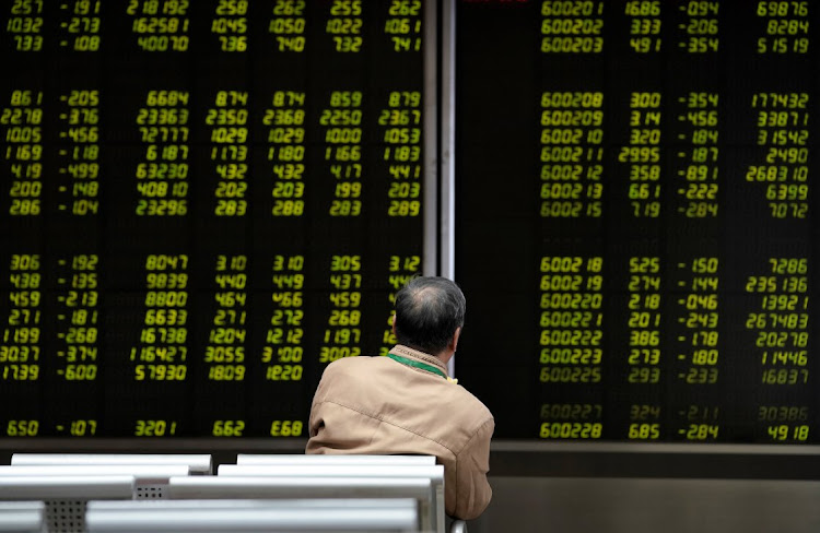 An investor watches a board showing stock information at a brokerage office in Beijing, China. Picture: REUTERS/JASON LEE