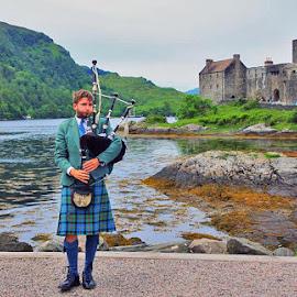 Eilean Donan Castle, Scotland by Preslava Gancheva - People Musicians & Entertainers ( castle, bagpipe, scotland )