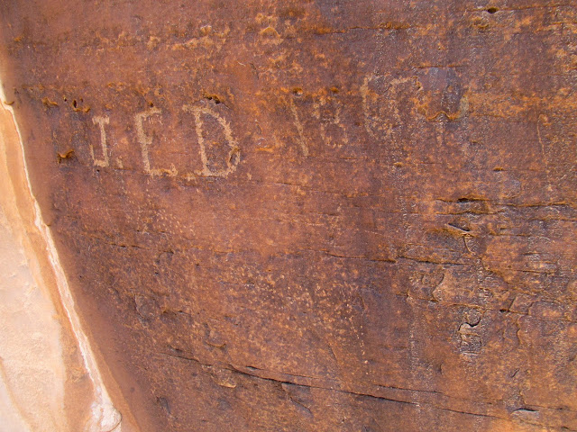 J.E.D. 1860 inscription, along with a faint pecked animal figure