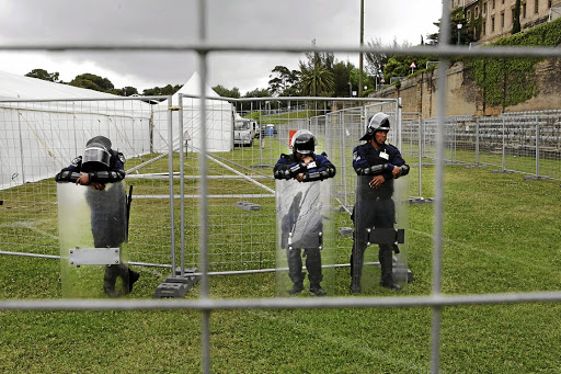 TESTING TIMES: Guards wait outside the giant tent on UCT's sports fields where students will be writing final exams.