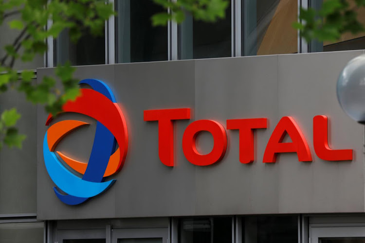 The logo of French oil giant Total is seen at La Defense business and financial district in Courbevoie, near Paris, France. Picture: REUTERS