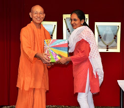 Photo: Mrs Meena, a member of The Reading Mums team receiving a token of appreciation, in recognition of her contributions, from Swamiji