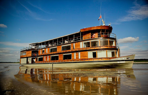delfin-II-on-the-water.jpg - The petite 28-passenger Delfin II sails the upper Amazon River.