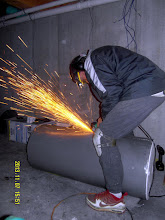 Photo: Gerg unzipping the water heater jacket.  We're gonna really insulate this baby!