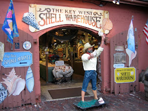 "Photo: Seashells at a Mallory Square shop. The large pink conch (pronounced like ""honk"") is the symbol of the Conch Republic of Key West"