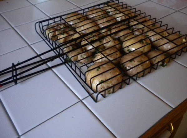 Put mushrooms in grill basket (or gill side down) over high flame for 4...