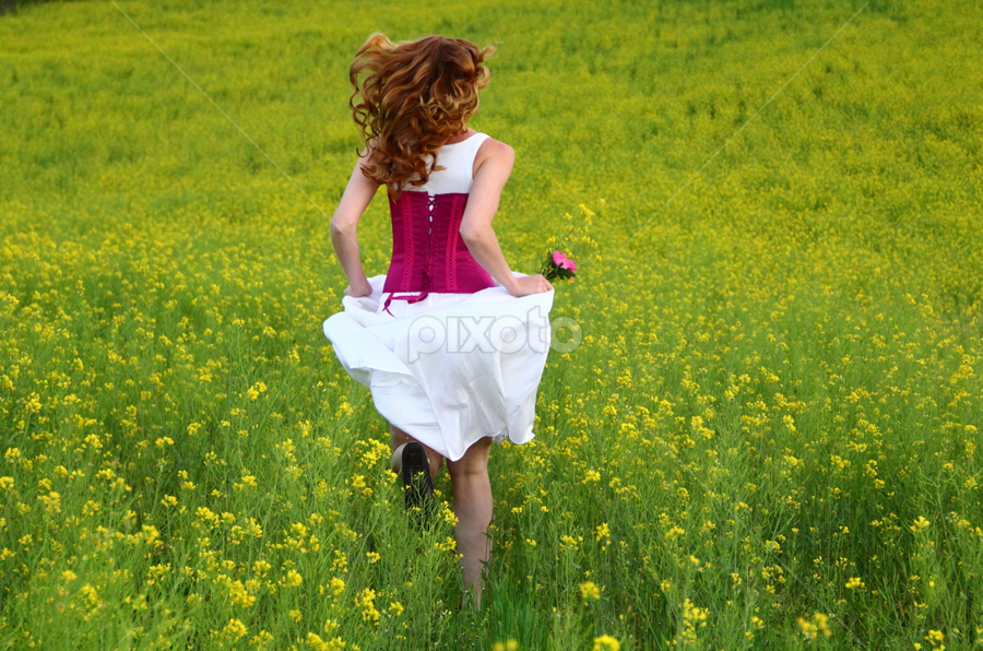 Run Away by Freda Nichols - People Portraits of Women ( field, woman, yellow, flowers, running,  )