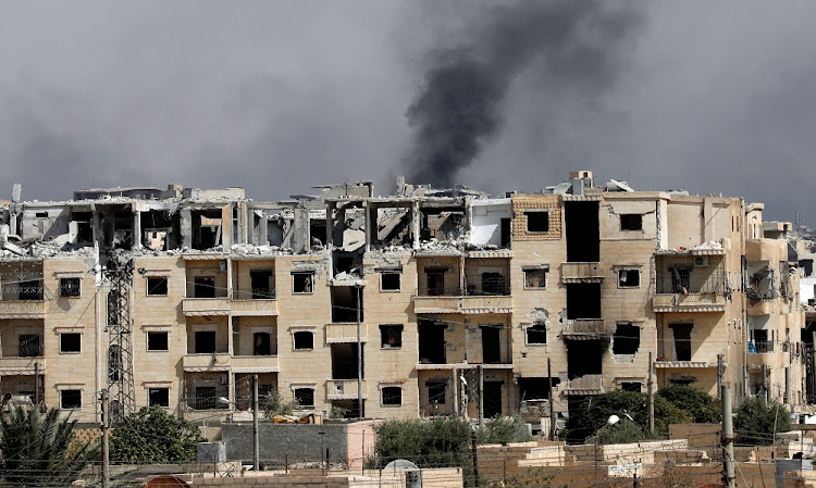 Smoke rises after an air strike at the positions of Islamic State militants in Raqqa, Syria, on Saturday. Picture: REUTERS