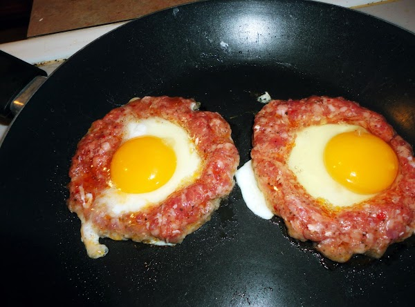 Crack an egg into the center of each sausage ring, cook 2-3 each side