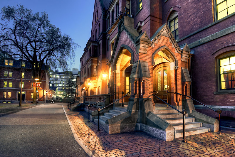 Photo: The Horror of Harvard Yard (Before/After Photoshop Edits: goo.gl/zHJNv )  To me, Harvard Yard at sundown was the epitome of creepy/cool (crool?). Although I'm sure it's a totally friendly place, I was really getting a Tower of Terror vibe and tried to play that up in the editing.  Harvard's campus had a lot of awesome old buildings, but not much non-student/staff parking :-/ Lori and I had to drive several loops through the campus before we finally settled on calling my friend Scott (who you may remember from Japan By Bicycle - http://goo.gl/HFD2L ) to park near his apartment and ask for a photo spot recommendation. Scott happens to live about 8 minutes away from Harvard and is fairly familiar with the campus. He's also familiar with my photography habits from our bike trip, and patiently waited while I took photos until my memory card ran out of space (jk, but I like to think he'd be cool with that).  -------------------------------------------------------------------------- #architexturetuesday curated by +Ranjan Saraswati #tonemaphdrtuesday curated by +Stephanie Suratos & +Drew Pion #moodymonday curated by +Philip Daly +Carole Buckwalter  #traveltuesday #hdr #architecture #POTD #photomatix #boston #harvard  #plusphotoextract curated by +Jarek Klimek #nightshot