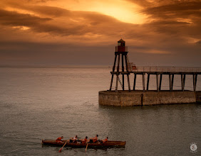 Photo: Before The Storm  A rowing crew coming into harbour at Whitby to beat the oncoming storm on the horizon.  It's been such a long time since I took a camera out never mind just for fun. We went to Whitby for a couple of days and I decided to take the Olympus rather than the Canon simply for weight and convenience. I have to admit in the past I have never given the Olympus a fair crack of the whip having been stuck in DSLR mode for a long while, also believing nothing could touch the 70-200mm F/2.8.  I have to admit that maybe I was wrong, not only is the camera and kit so much easier to lug about the quality of the images you can get really surprised me. This is with the OMD E-10 so I wonder how the 1 or even the new 5 would perform. I may need to look at investing in a wide angle lens and see how it performs for other landscapes?