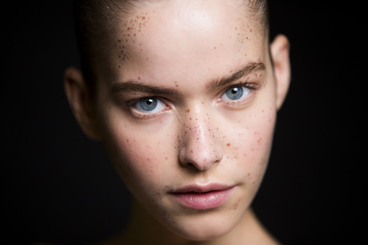 The most natural placements for faux freckles are across the bridge of the nose with a light sprinkling on the forehead.