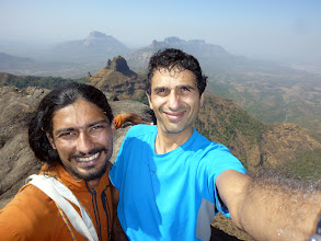 Photo: Richard Kher and Sunny Jamshedj in a selfie on Chanderi's summit with several pinnacles and buttreses in the background between Badlapur (visible in the distance on the right) and Panvel, which would be directly to our left.