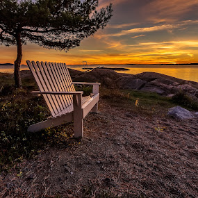 by Bent Velling - Landscapes Sunsets & Sunrises ( water, clouds, ef17-40l, canon 6d, benro, warm, bench, sunset, trees, rocks, sun, norway )