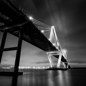 Skyline Evening Reflections of Charleston Bridge by Norma Brandsberg - Black & White Buildings & Architecture ( contracy, reflection, photograph, harbor, www.elegantfinephotography.com, suspension, horizon, cityscape, photo, norma brandsberg, photography, nbrandsberg@gmail.com, foggy, charleston, fog, award winning, sunset, vista, night, bridge, view, light, evening, hire,  )